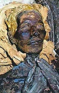 mummy of Yuya, ancient Egyptian noble who was the grandfather of the Pharaoh Akhenaten. The gold hair colour is as a result of the mummification process used, but you can clearly see he has straight/wavy hair. Mummies and mummy hair from ancient Egypt.