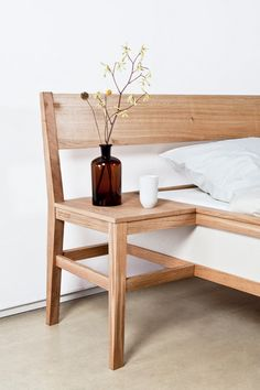 Bed frame with integrated side tables by Roy Letterle