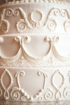 Royal icing is used to create 3-D designs, scrollwork, and flourishes on wedding cakes