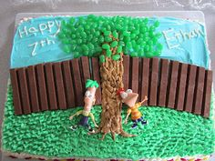 Phineas and ferb cake I made the fence out of Kit-Kats, the Phineas and Ferb characters are plastic figurines, and the tree and grass are piped icing.  Oh, and jelly bean leaves!