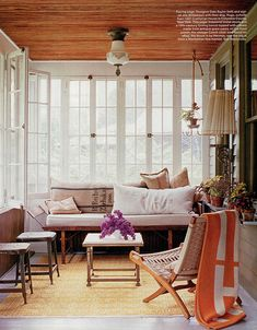 small sunroom, love the mix of metal and wood furniture and the natural wood elements in the room
