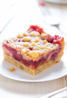 Strawberry Lemonade Bars - Imagine crossing lemon bars with a strawberry pie. These easy bars taste like strawberry lemonade! Sooo good! Perfect for spring and summer!