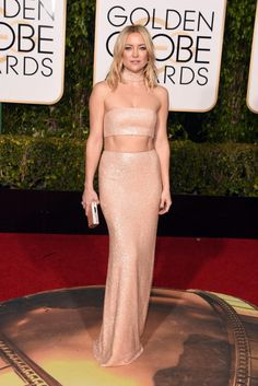 Kate Hudson made sure she turned heads on the red carpet in a crop top and matching skirt in a nude sparkly Michael Kors Collection ensemble that revealed her abs at the 2016 Golden Globes on Jan. 10, 2016.