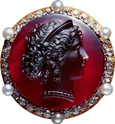 Diamond, pearl and garnet cameo brooch.