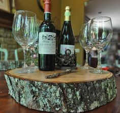 Turn a tree trunk slice into a tray.  Make different sizes and heights for a rustic food display.