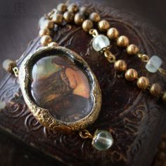 """""""The full moon is made her mirror""""  Venus' Looking Glass   Pictorial Necklace by ParrishRelics on Etsy, $92.00"""