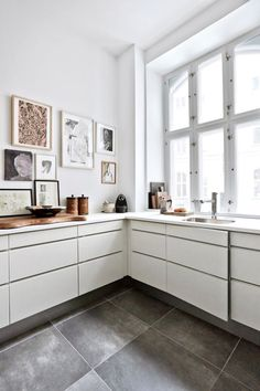 dustjacketattic:  gallery wall | modern kitchen | photo birgitta wolfgang