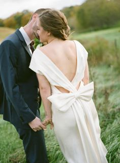 For the brides that love bows! http://www.stylemepretty.com/2015/11/30/backless-dresses-for-the-winter-bride/ Photography: Emily Steffen - http://www.emilysteffen.com/