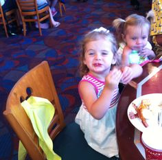 Abbie and Lilly eating breakfast at Disney world .