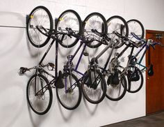 Optimize Limited Bike Storage Space Bicycle Wall Rider Hanging Bike Storage Bracket | WireCrafters - Multiple bikes can be stored in a small amount of space.