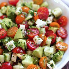 Tomato, cucumber, avocado salad. I use mozzarella instead of feta.