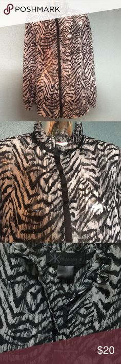 Kardashian Kollection sheer printed buttondown Sheer animal print button down top. Super cute ruffle around top as collar. Buttons are covered with a piece of black grosgrain ribbon. Shirt is NWOT. Still has tag with spare button in it on shirt. Has never been worn. Kardashian Kollection Tops Button Down Shirts
