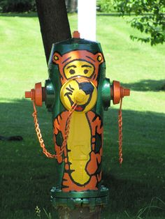 Painted fire hydrant (Tony the Tiger) in New Carlisle, Quebec, Canada.  by Hans Raffelt