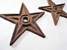 Perfectly aged architectural salvage. 7 diameter cast iron masonry stars are perfectly rusty and would make a nice addition to your industrial decor.  Cast iron masonry stars were originally devised as an anchor plate or large washer intended to provide structural support to a masonry (brick) wall. No longer used in construction but these cast iron stars are great for wall decor in your garden or industrial studio.  1/2 thick at the tallest rib; 1/4 thick iron plate everywhere else. 6 5/8…
