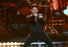 He will, he will, rock you. Adam Lambert goes hard during a performance with Queen at the 2013 iHeartRadio Music Festival on Sept. 20 in Las Vegas�