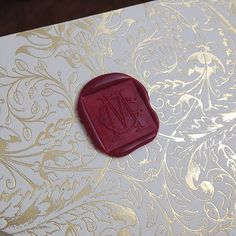 Luxe red wax seal on gold foil for a game of thrones inspired wedding…