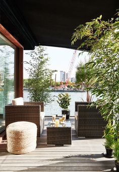 Lush and cozy terrace with lots of green plants and lounge atmosphere with outdoor furniture from White Stores.