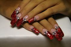 Red with bling. Is it me or the photo. These nails look like they are layered up past the nail. Is that the effect they were going for. Btw. I love the red. Gorgeous. The blonde in the pic.