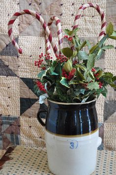 stone jar with holly