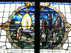 "Stained glass window of Our Lady of LaSalette at the Shrine of LaSalette, in Enfield, New Hampshire. The inscription, loosely translated says, ""Make the move to all my people""."