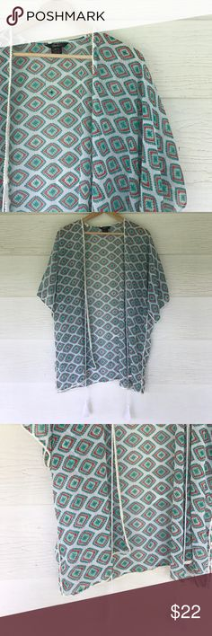 Kimono jacket New without tags. Size xl. Greens and a bit of red on designs. Short sleeves.  Creamy white background. Tops