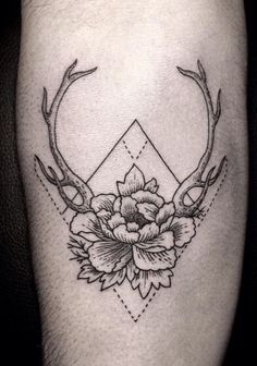 Several different things I like in one. Definitely a tattoo I'd consider getting. Deer ears, flowers, and triangles. Love this tattoo. Would get this on the back of my neck.