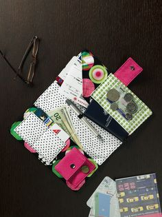 Travel wallet - wouldn't it be fun to make into a needlework etui - the pockets could be wool felt with a little hand embroidery - Mary Corbett's Lavender Honey & Other Little Things comes to mind..... hmmmm..... Stitching Group??