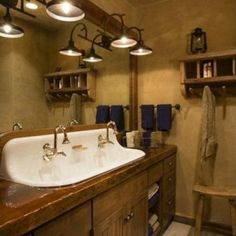 White Trough Sink Combined with Wooden Vanity Cabinet and Nice Bathroom Lighting Idea