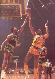 Bill Russell, the winningest player of all time v. Wilt Chamberlain, the offensive machine. Battle of the Titans