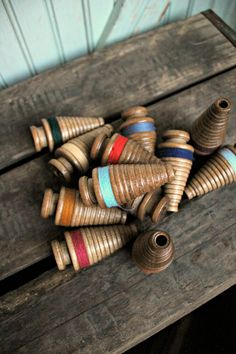 I just discovered these over at Worthy Goods....I didn't even know they existed! They're vintage industrial thread bobbins that would be perfect repurposed as Christmas ornaments or miniature 'trees' for holiday decor!