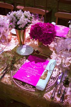 How exquisite are these charger plates? Magenta dinner menus and crisp white dinner napkins secured by gold tassels complete the look.