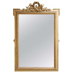 19th Century Louis XVI Style Grand Scale Giltwood Mirror with Crossed Torches   From a unique collection of antique and modern wall mirrors at https://www.1stdibs.com/furniture/mirrors/wall-mirrors/