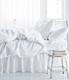 love all white bedding. so clean and fresh.