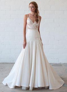 Tara LaTour Fall 2016 white illusion V-neckline bodice and trumpet silhouette wedding dress | https://www.theknot.com/content/tara-latour-wedding-dresses-bridal-fashion-week-fall-2016