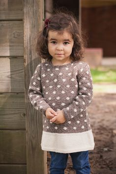 This sweet polka dot pullover is perfect for blustery days. A simple shape with special details, like the ruffled skirt, bring out the natural beauty of the yarn. Available in 9 sizes for all the little ladies in your life.