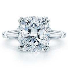 Cushion cut diamond engagement ring and two tapered baguettes