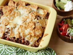 """Beef and Bean Taco Casserole : Food Network Kitchen nicknamed this the """"broken enchilada"""" casserole because the soft layer of cooked tortilla chips on the bottom is reminiscent of enchiladas. But this dish is much easier to make! via Food Network Taco Casserole, Casserole Dishes, Casserole Recipes, Casserole Ideas, Cheeseburger Casserole, Breakfast Casserole, Tex Mex, Quesadillas, Enchiladas"""
