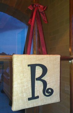 Front door decoration. Painted wooden letter, canvas, burlap and ribbon.