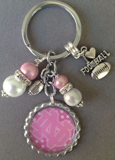 This listing is for one Notre Dame bottle cap key chain.  This key chain is embellished with pink and white beads, an I Love Football charm and a football.   You can choose from any image in the collage. Just let me know during checkout. The beads will always look great and coordinate:)  Ha...