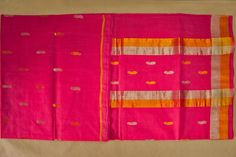 Traditional mango motifs weaved on the saree.