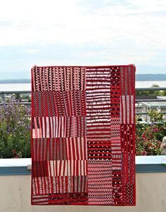 Thinly Slices by Debbie Via Flickr: an improv stripes quilt