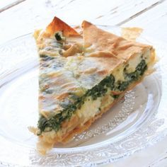 Spinach and Feta Pie from Jamie Oliver's 30 minute meals book Recipe with pinenuts, eggs, feta cheese, shredded cheddar cheese, oregano, lemon, olive oil, baby spinach, filo, nutmeg