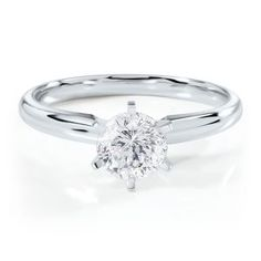 This is simple yet so beautiful. To be honest even a one stud diamond engagement ring would be enough for me!!!!