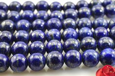 A grade-64 pcs of Lapis Lazuli smooth round beads in 6mm