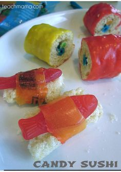 Candy Sushi, the only kind of sushi I would eat. Rice Krispie Treats–along with another love of mine, Swedish Fish. And Fruit Roll-Ups. And gummy worms, bears, or M & M's. All wrapped into one happy little sushi roll. how to make candy sushi Yummy Treats, Sweet Treats, Yummy Food, Candy Sushi Rolls, Kids Party Treats, Kinds Of Sushi, Reis Krispies, Fruit Roll Ups, Thinking Day