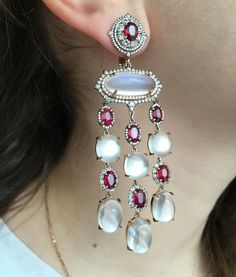 Rubies no heat, diamonds and white Burma moonstones.