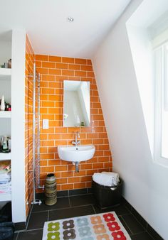 Again, the boys love orange but I'm afraid of long-term commitment. Perhaps an accent wall, occasional tile insert, or wall color would suffice. - Jane and Rob's Inspiring London Townhouse House Tour | Apartment Therapy