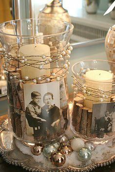 Black and white photos in bell jars w/ sticks wrapped around candle
