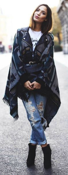 Sofya Benzakour wears a gorgeous traditional style poncho over ripped denim jeans and with a pair of wedge heeled boots. Poncho: Fashion Pills, Jeans: Mango, Boots: Primark, Tee: Majestic Filiatures. http://www.justthedesign.com/blanket-coat-trend-we-round-up-the-best-in-ponchos-and-blanket-coats/