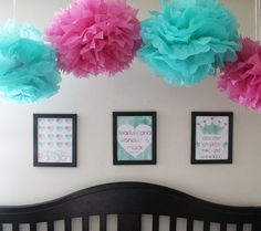 Poofs~ I have pink, teal and white hanging from the ceiling above Adelyn's crib. Bought at party city.